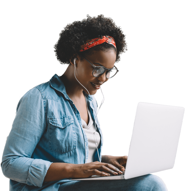 Photo of young African-American female student with headphones in looking at something on laptop computer